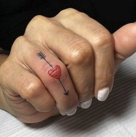 Heart and Arrow Tattoo on the Finger