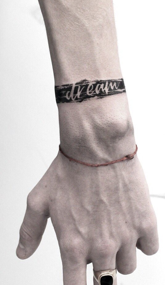 Negative Space Lettering Tattoo