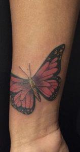 Purple Tattoo on Dark Skin