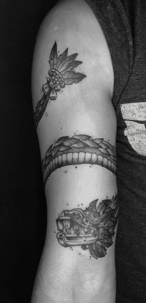 Quetzalcoatl tattoo on the arm