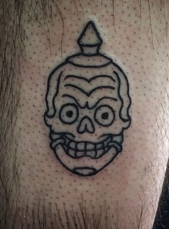 Small Tibetan Skull Tattoo