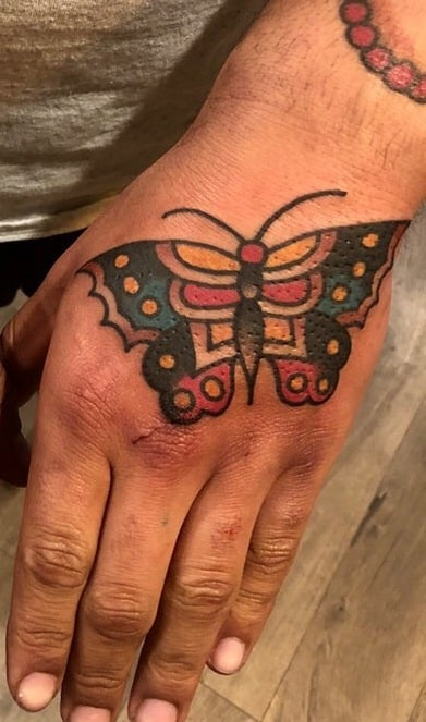 Traditional Butterfly Tattoo on the Back of the Hand