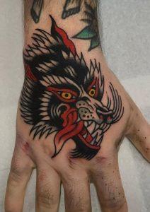 Traditional Wolf Hand Tattoo