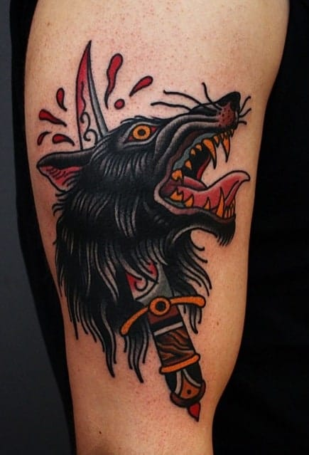 Traditional Wolf and Dagger Tattoo