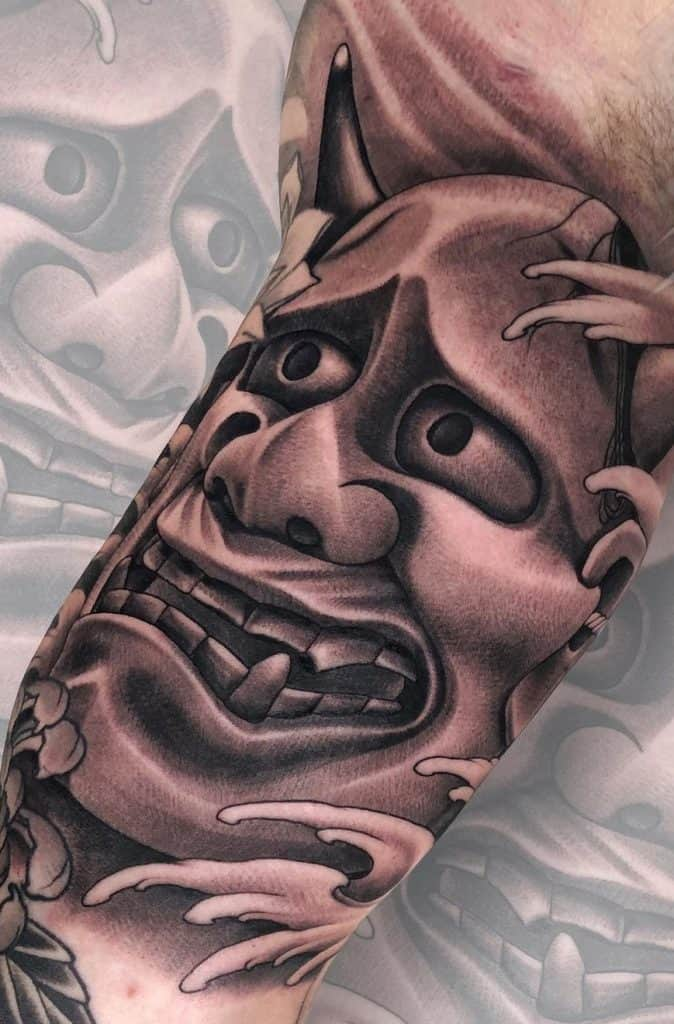 Black and Grey Hannya Mask Tattoo