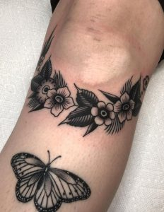 Black and Grey Traditional Flower Tattoo