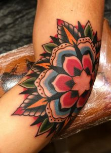 Traditional Flower Elbow Tattoo