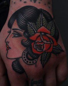 Traditional Flower Hand Tattoo