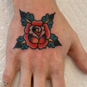 Traditional Flower Hand Tattoo