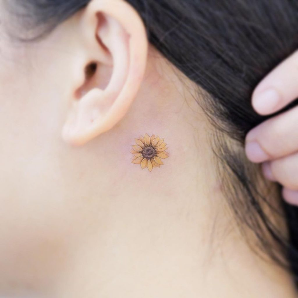 Small Sunflower Tattoo Behind the Ear