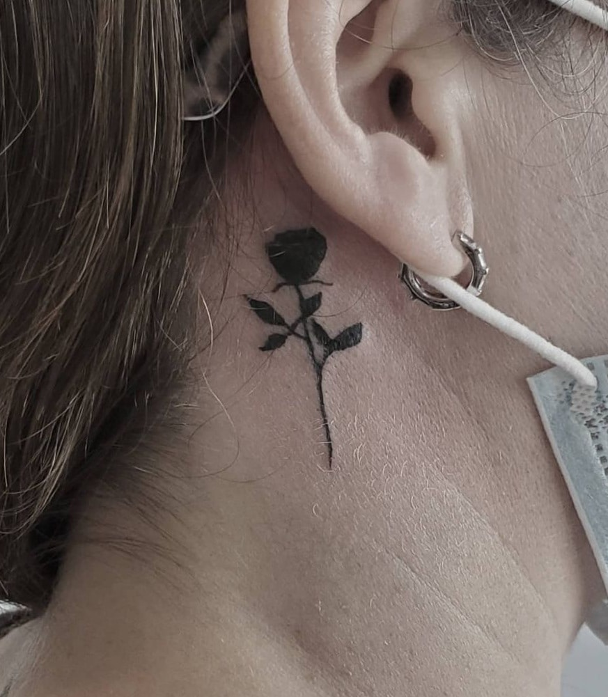Small Rose Tattoo behind the Ear