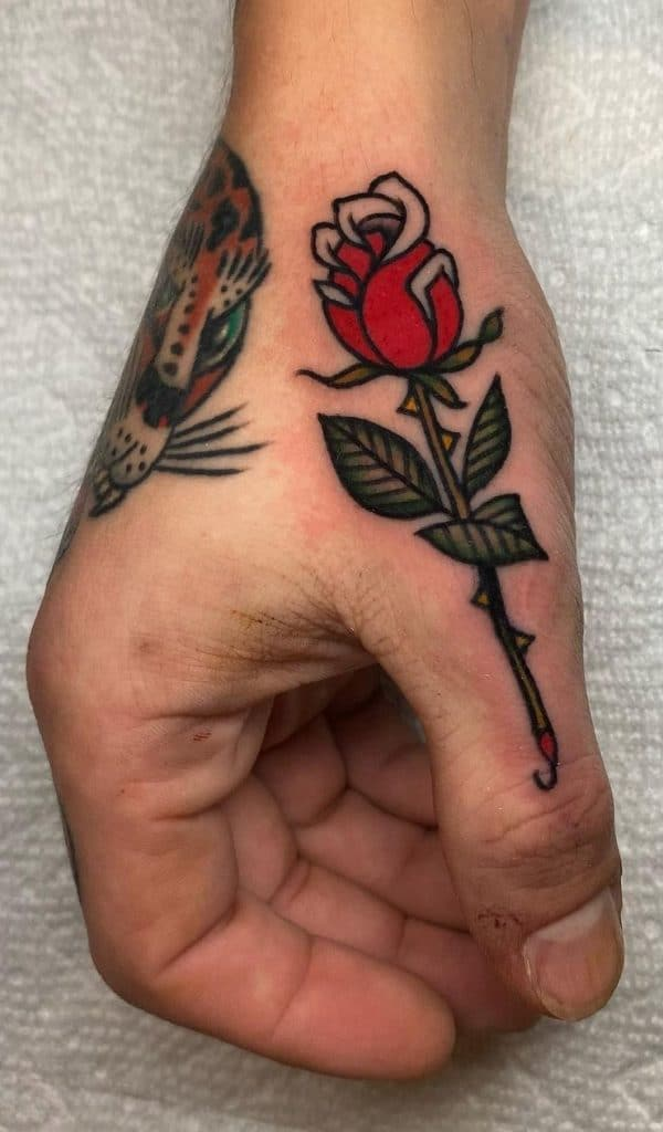 Small Rose Tattoo on Finger